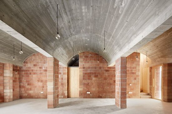 aulets arquitectes' vaulted brickwork reflects the historic architecture of mallorca